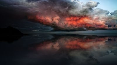 Water Under Red And White Clouds