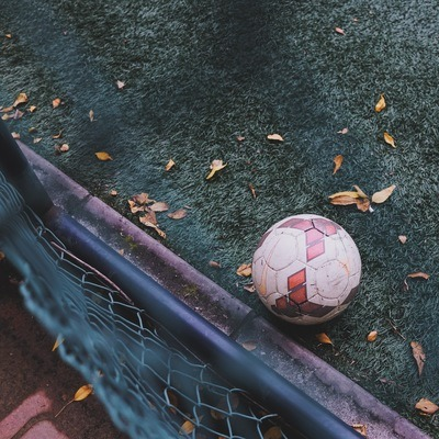 White And Red Soccer Ball on Green Grass
