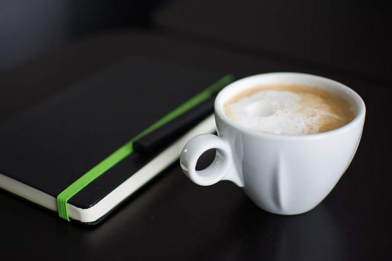 White Cup of COffee on Black Surface