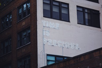 White Time Is Precious Signage Building