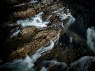 White Water Rushes Over Rocky Edge