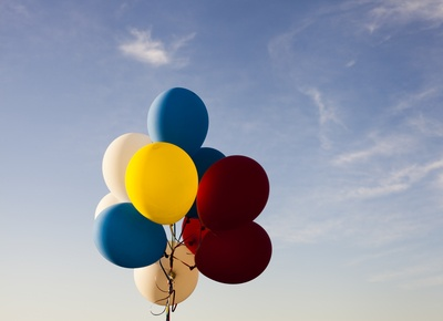 White, Yellow, Red, And Blue Balloons