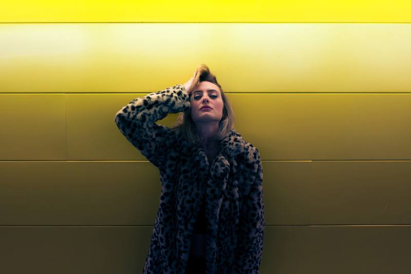 Woman By Yellow Wall