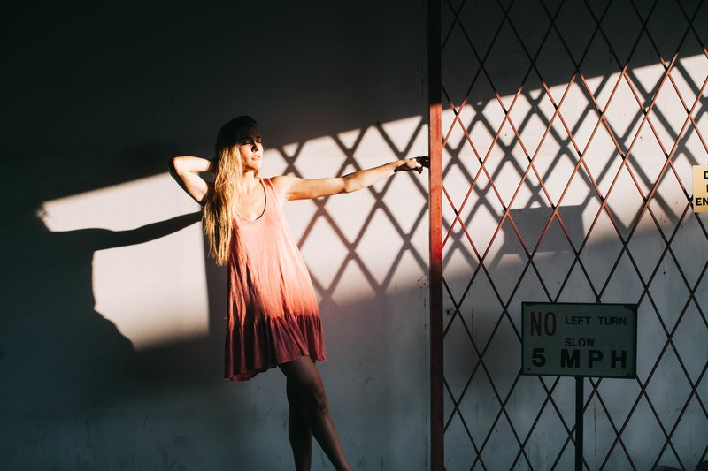 Beautiful Woman Holding Red Steel Gate