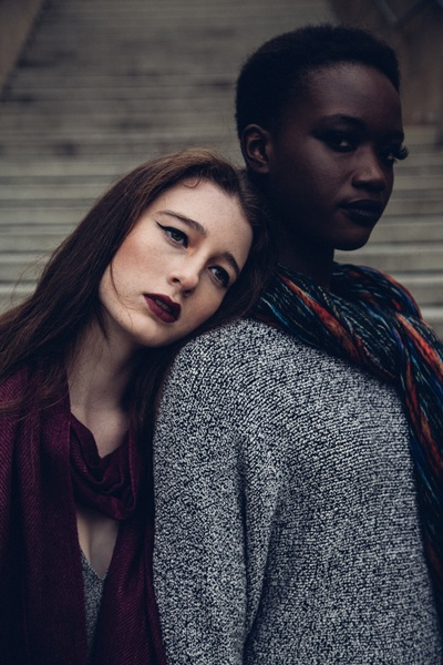 Woman Leaning Her Head To Another Woman