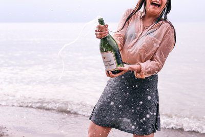 Woman Popping Champagne