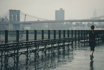 Woman Running Near the Water with Brooklyn Bridge in