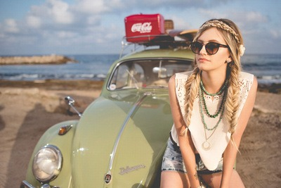 Woman Sitting on Volkswagen Beetle Parked on