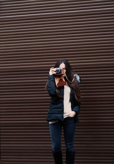 Woman Standing Holding Camera Taking