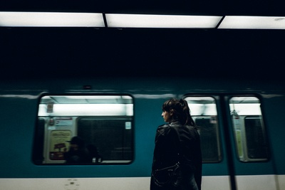 Woman Standing Near Closed Train Door