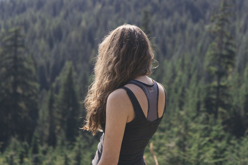 Woman Standing While Watching Green Trees