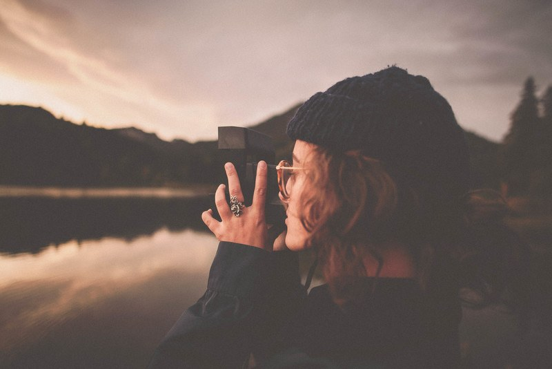Woman Taking A Picture of Water