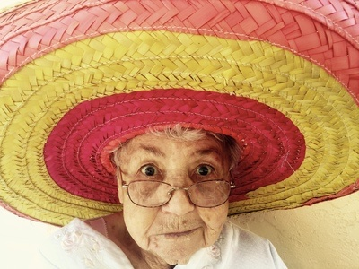 Woman Using Eyeglasses And Wearing Hat