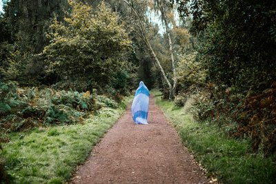 Woman Walking Path With Head Covered