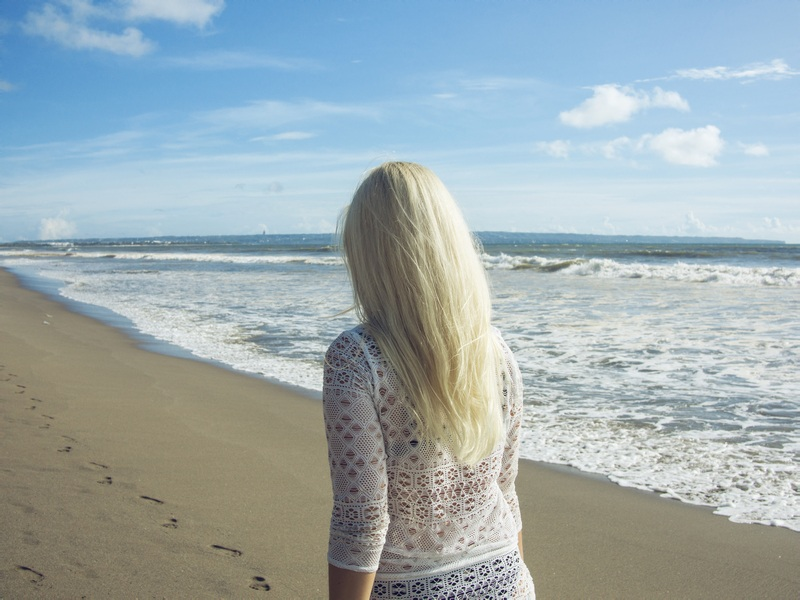 Woman Walking on Shore During Day