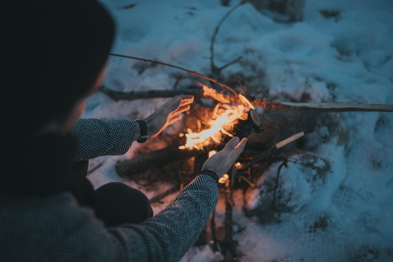 Woman Warming at Camp Fire