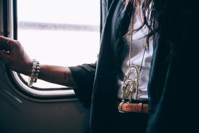 Woman Wearing Necklace On Train