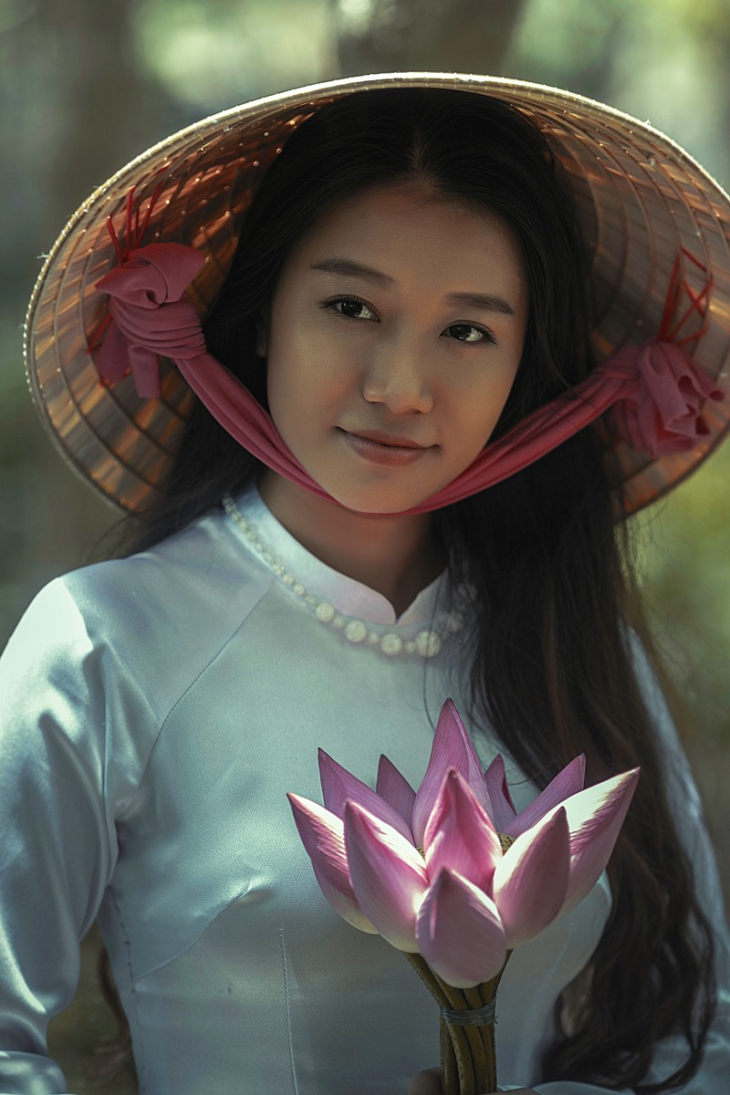Woman Wearing White Long-Sleeved Dress And Brown Sungat Holding Pink Petaled