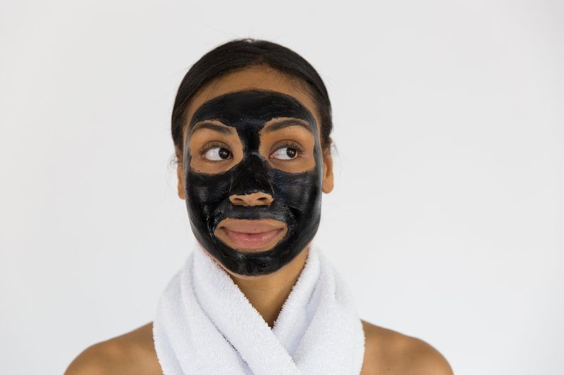 Woman With Charcoal Face Mask