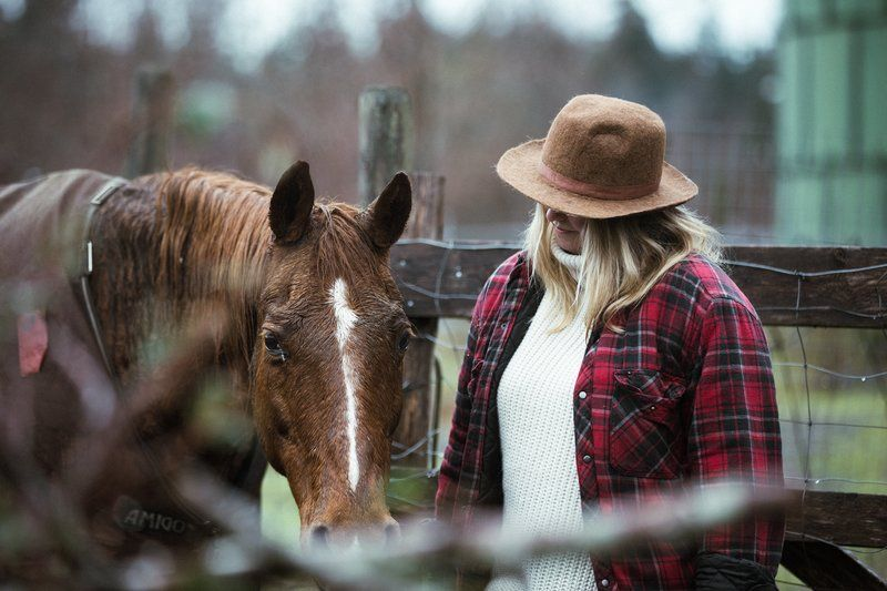 Woman With Horse In Corral