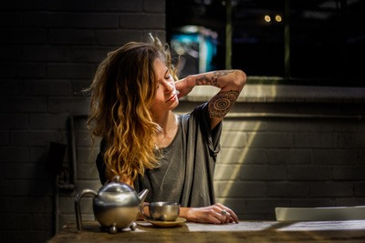 Woman With Tattoo & Long Hair