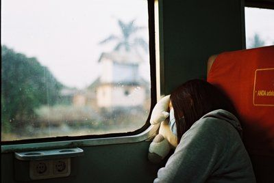 Woman in Grey Hoodie Sleeping in A Train with Face Mask