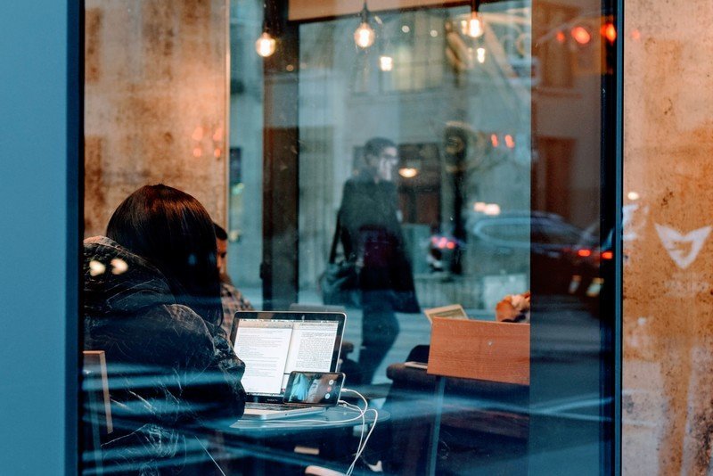 Woman inside A Building Using Her Laptop