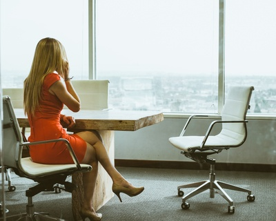 Women in Office Chair Talking on Phone