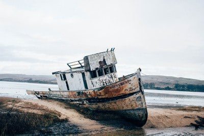 Wrecked White And Brown Ship on Sand