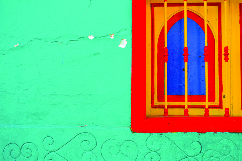 Yellow And Red Window Along on Green Painted Wall