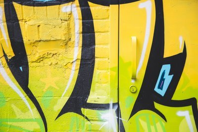 Yellow Black Spray Painted Wall