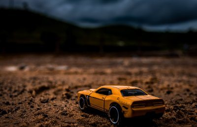 Yellow Toy Car In Dramatic Desert Landscape