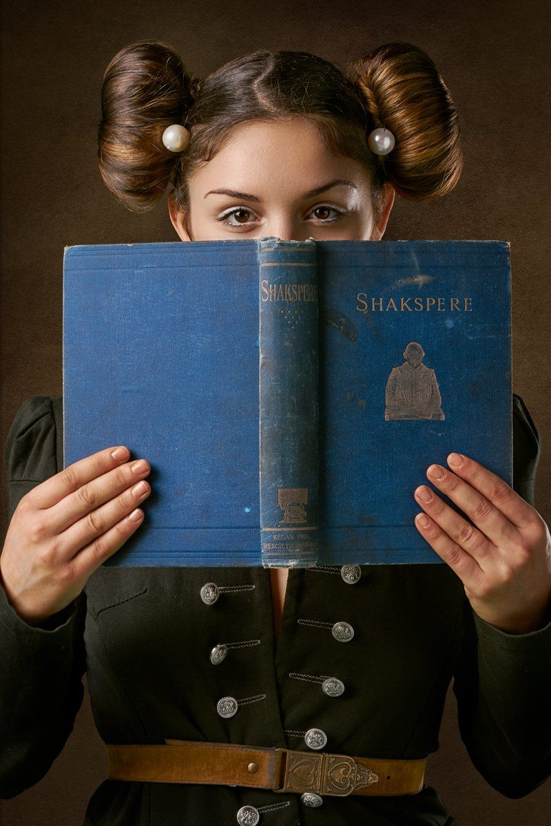Young Woman Holds An Antique Book