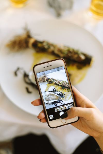 Young Woman Snaps Photo Of Food