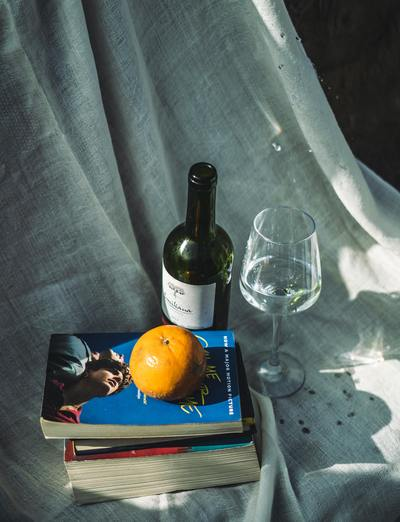 Books and wine on a blanket