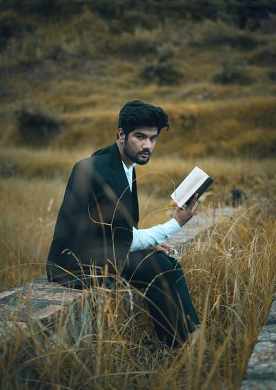 Man reading a book in nature