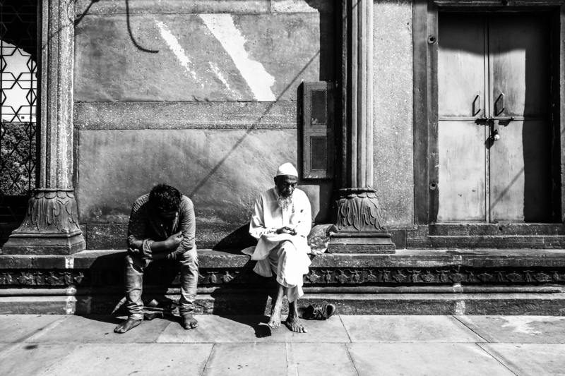Indian men sitting on stairs