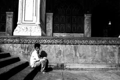 Indian boy sitting on stairs