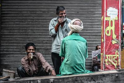 Indian men laughing on the street