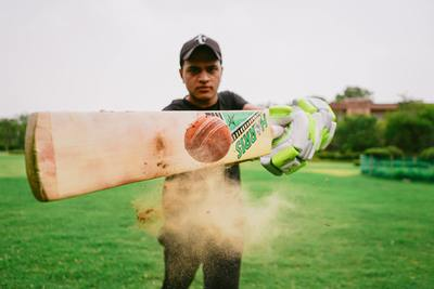 Cricket player hitting the ball