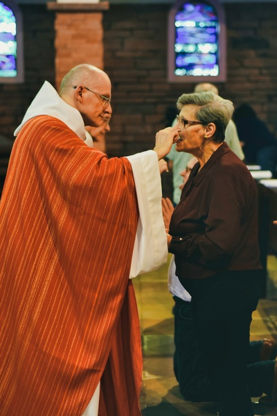 distributing the holy communion